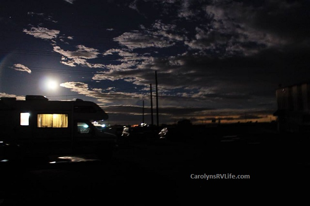 Stranded at auto repair shop on an RV - cloudy moonlit sky